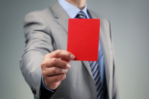 Showing the red card concept for bad business practice, exclusio